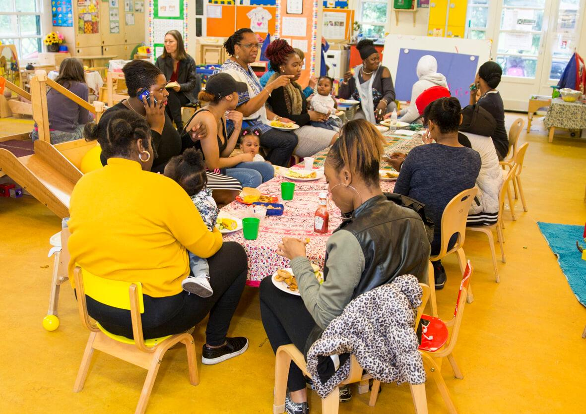 parents and children enjoying lunch