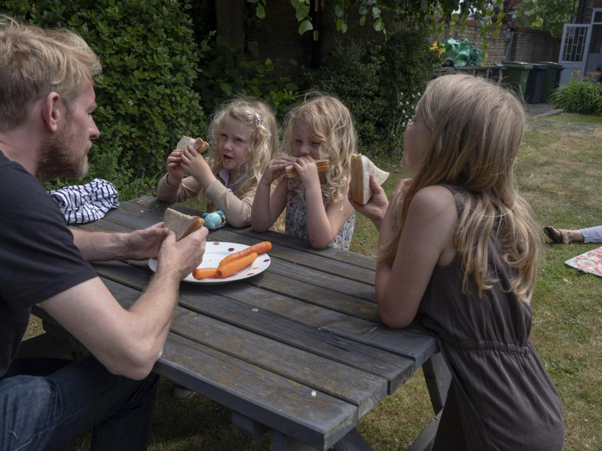 A family eating lunch at a centre