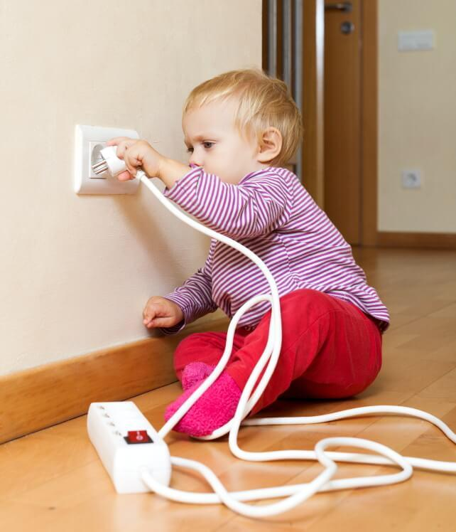 child playing with electric socket